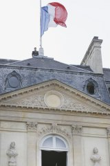 The French flag flies at half mast at the Elysee palace in Paris.