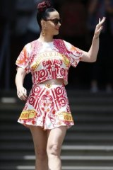 Katy Perry waves to her Loreto Mandeville fans.