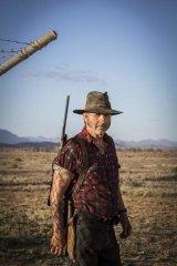 John Jarratt as Mick Taylor.