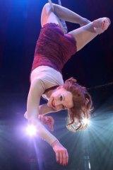 Trapeze artist Krin Haglund plays a desperate-for-love secretary in <i>La Vie</i>.