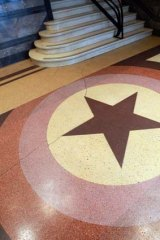 The City of Melbourne is seeking to protect the Orange Order star motif, made of patterned terrazzo, in the foyer of Centenary Hall in Exhibition Street.