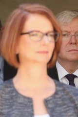 Julia Gillard admits that deposing Kevin Rudd as prime minister damaged her reputation.