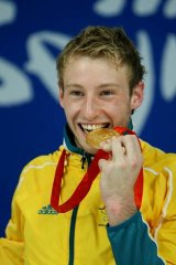 The highs ... Matthew Mitcham celebrates winning gold in Beijing.