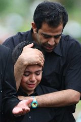 Seena, 9, grieves at the funeral for an eight-month-old baby drowned when an asylum-seeker boat broke up on rocks on Christmas Island.