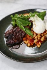 Rich flavour: Brisket slow-cooked in coffee and bourbon with poached eggs and beans.