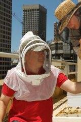Urban bee-keepers Doug Purdie and Victoria Brown.
