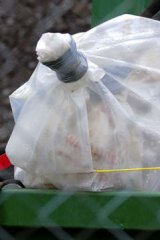 A bag of asbestos left in open-topped skips in the front yard of contractor business in Ballarat.