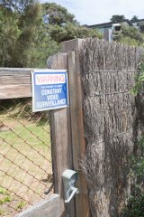 No way: A locked gate bars the beach access through Lindsay Fox's property.