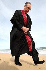 Federal Court judge Tony North, with shoes off to feel the land, on Victoria's south-west coast yesterday.