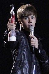Canadian singer Justin Bieber accepts his best International Breakthrough Act award.