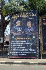 A poster for Laskar Bali at a roundabout in Denpasar.