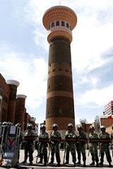 Soldiers guard the Dong Kuruk Bridge mosque in Urumqi.