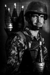 Portrait of a soldier ... members of the Afghan National Army following a patrol in the Arghandab Valley.