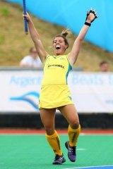 Kellie White celebrates a Hockeyroos goal.