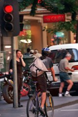 A cyclist appears to ignore a red light on Collins Street, Melbourne.