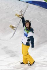 That winning feeling ... Torah Bright salutes the crowd after her second run.