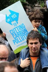 """Supporters of the national carbon tax rally outside the Melbourne State Library as part of """"Say Yes"""" week."""