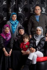 Support from Australia ... Asma Zaki Elsaed, centre, with her children, from left, Alaa, seated 18, Aya, 20, Omar, 3, Noor, 12, and Osama, 23, in their Greenacre home.