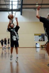 Anson Thai puts up a shot during the 2 on 2 at Southern Cross Stadium yesterday..