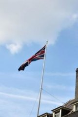 The Scottish flag flies alongside the Union flag over the Prime Minister's residence in Downing Street.