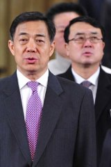 Missing in action ... China's Chongqing Municipality Communist Party Secretary Bo Xilai, and Chongqing  deputy mayor Wang Lijun, right, sing the national anthem in January.