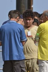 Asylum seekers are processed by Australian officials.