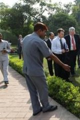 Prime Minister Julia Gillard walks past the spot where she tripped earlier during her official visit to India.