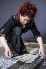Artist Hannah Bertram prepares her dust installation at La Trobe University Museum of Art.