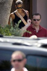 Michelle Obama leaves the Spanish resort. <i>Picture: AFP</i>