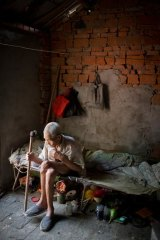 Dou Shengli , 87, lives with his 85-year-old wife He Xiuying in a typical one-room house in Gonggou.
