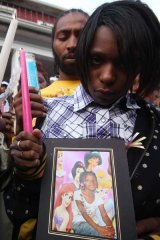 The mother and father of Aiyana Jones gather for a candle light vigil for seven-year-old daughter Aiyana Jones.