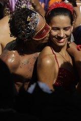 Revellers attend the Carmelitas carnival parade in Rio de Janeiro.