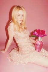 Dakota Fanning in a perfume advertisement.