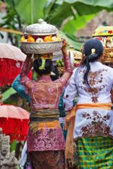 Gifts for the gods … women carrying temple offerings.