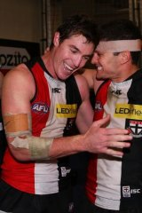 Lenny Hayes (L) of the Saints celebrates a win with Leigh Montagna.