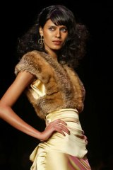 Buyer beware … a model wears a faux fur vest.