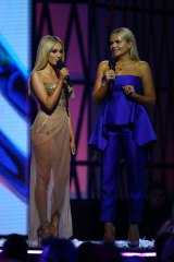 Alli wears blue Carla Zampatti to present with Samantha Jade at the ARIAs.