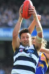 Geelong's Jimmy Bartel marks in front of West Coast's Mark Nicoski in their preliminary final at the MCG.