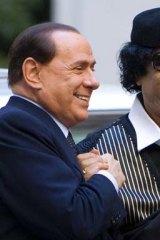 Muammar Gaddafi with Silvio Berlusconi.