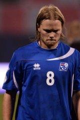 Iceland midfielder Birkir Bjarnason leaves the pitch.