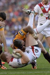 Upended: Ben Creagh of the Dragons is picked up and driven into the ground by the Broncos defence.