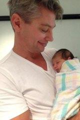 Snug: Luke Ricketson and his baby daughter Sophia Edie.