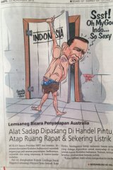 "A caricature on the front page of an Indonesian newspaper depicts Abbott as a peeping tom, prising the door of Indonesia open with his hand down the front of his pants. He's moaning: ""Ssst! Oh My God Indo ... So Sexy""."