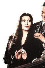 Anjelica Huston as Morticia in The Addams Family movie with  Raul Julia.