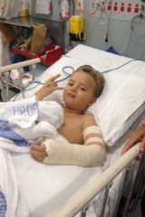 On the mend: Harry Bailey, now 8, was trampolining at a birthday party when he broke his arm.