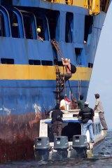 Change of guard: A fresh team of Australian customs officials board the Oceanic Viking.