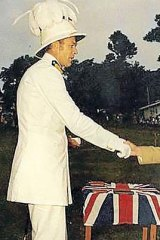 Andrew Stuart receives the British flag on Independence Day.
