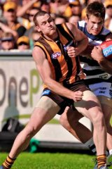 Hawthorn's Jarryd Roughead and Geelong's Tom Hawkins clash at the MCG.
