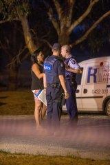 A woman speaks to police in Tyabb.
