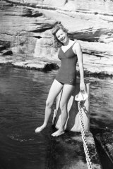 A swimmer tests the water at Coogee in 1947.